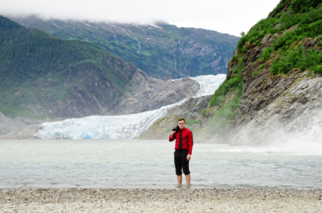 Senior standing in Mendenhall Glacier water