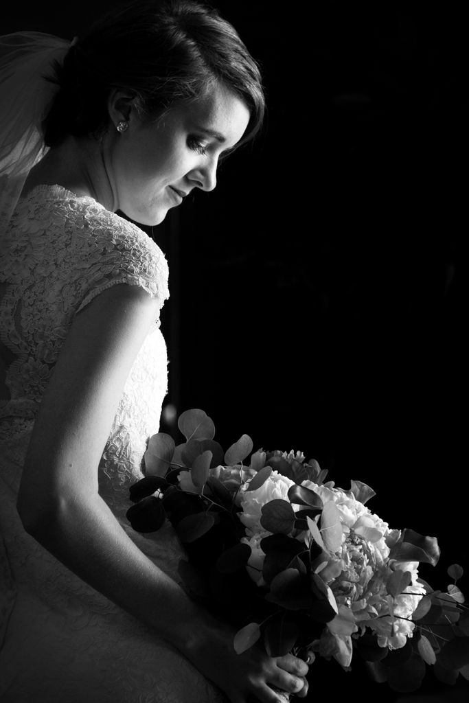 A bride with flowers in shadow