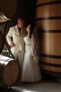 Wedding couple with wine barrels