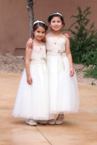 sisters share a flower girl moment