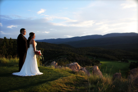 Bride and groom watching the sunset at Pakko