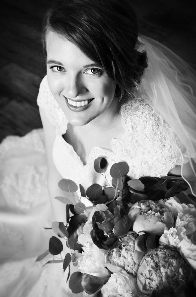 Bride sitting in a beautiful dark church